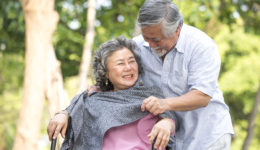 elderly couple enjoying the park together during hospice care