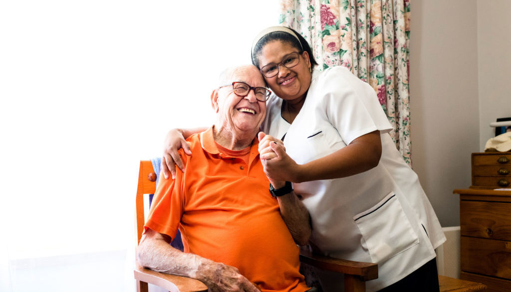 iStock-man-and-professional-caregiver-smiling_for-web