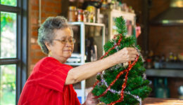 bigstock-Senior-Woman-Decorating-The-Ch-398376164